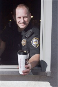 officer-handing-out-safety-tips-with-coffee